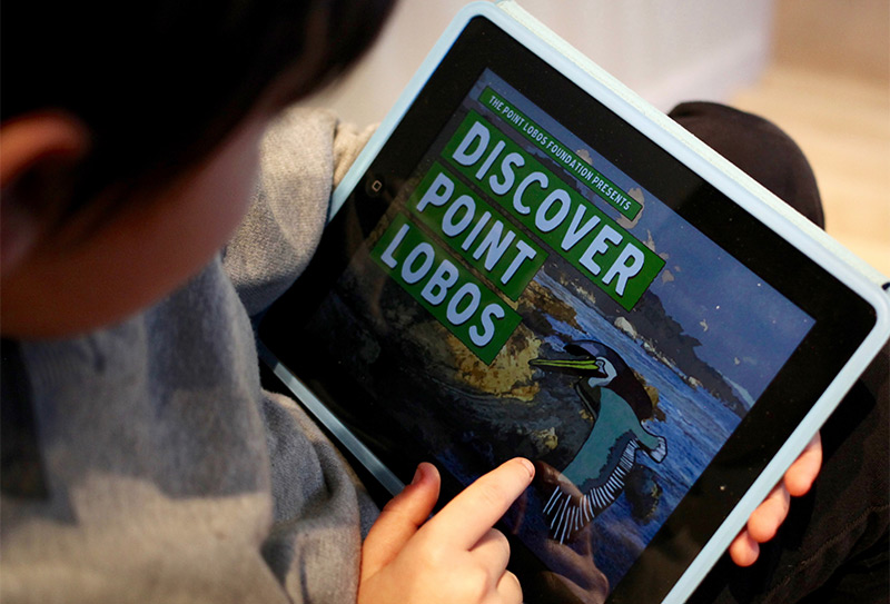 Child using Discover Point Lobos app on an ipad